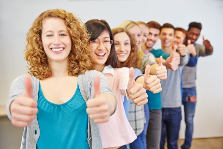 congratulating: Happy group of many teenager congratulating with thumbs up