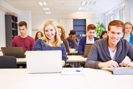 computer lessons: Students learning with computers in a university class Stock Photo