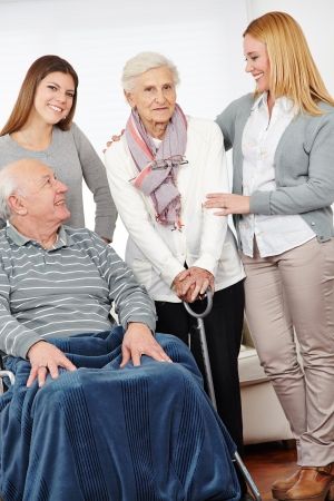 eldercare: Eldercare nursing service at home for senior citizen couple Stock Photo