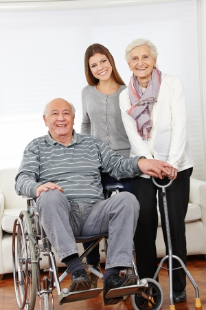 Happy family with senior citizen couple and granddaughter at home Stock Photo