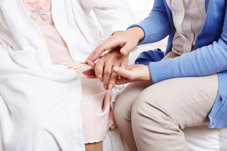 mobility nursing: Woman holding hand of senior woman in nursing home
