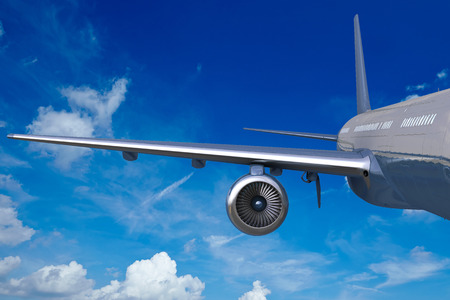jet engine: Wing of an airplane in the blue sky with white clouds Stock Photo