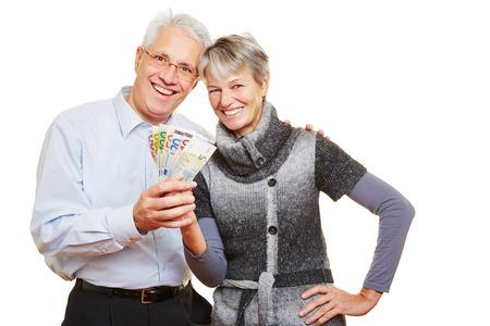 Happy senior couple holding a fan of Euro bills Stock Photo