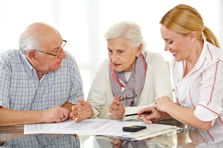 advice: Senior citizens couple argueing over a contract with financial advisor