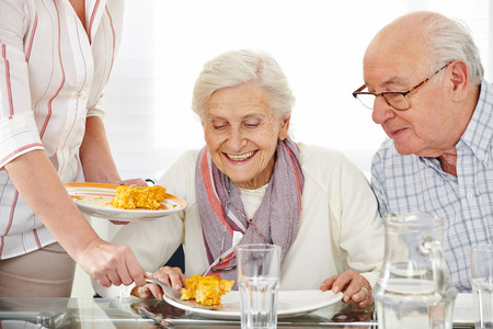 Senior citizens couple eating lunch at nursing home Stock Photo