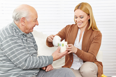 eldercare: Senior man and woman drinking coffee with milk