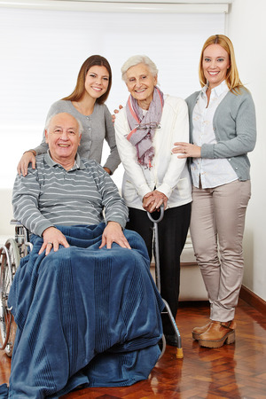 Family with three generations and senior couple at home photo