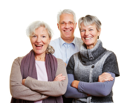 retirees: Group of happy senior people smiling with their arms crossed