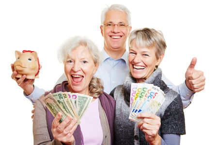 Happy senior people with Euro and dollar bills and piggy bank holding thumbs up photo