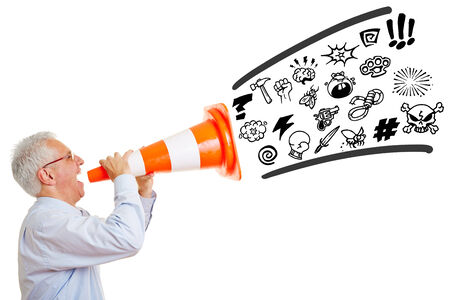 Senior man screaming curse words and insults in a pylon Stock Photo