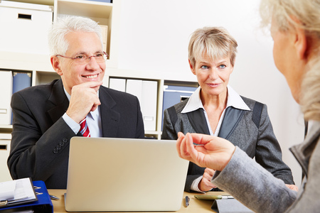 Elderly woman getting financial consultation in a bank Stock Photo - 27497351
