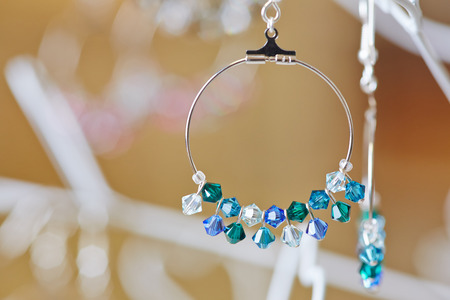 Fancy earrings from a jeweler on display at a jewelry store photo