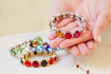 Woman holding a bracelet in her hands in a jewelry store photo