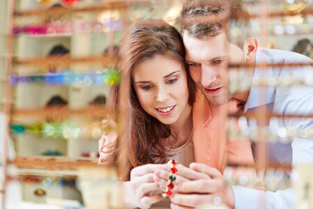 Happy couple buying together juwelry in a store photo
