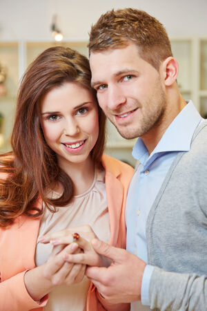 woman searching: Happy couple buying a ring at a jewelry store Stock Photo
