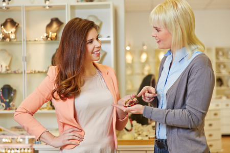 jeweler: Personal Shopper with woman at jeweler buying jewelry Stock Photo