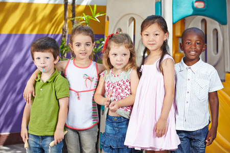 Many happy children in interracial group in a kindergarten photo