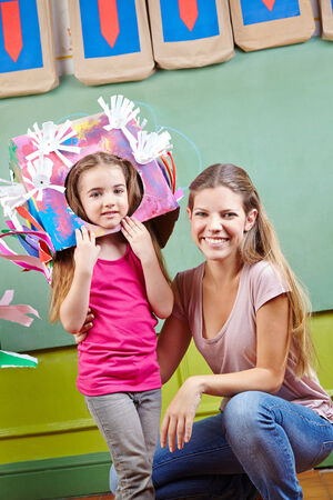 day care: Happy mother with herdaughter in DIY costume for carnival in kindergarten