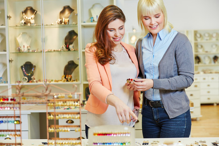 personal shopper: Personal Shopper advising woman in jewelry store while buying a bracelet