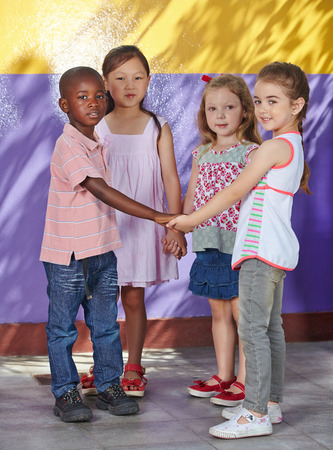 Interracial group of children learning dancing in a school class photo
