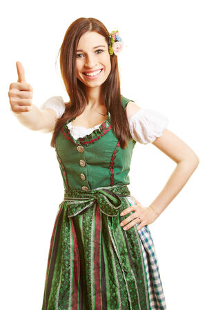 dirndl dress: Smiling happy woman in green dirndl dress holding her thumbs up Stock Photo