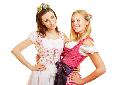 dirndl dress: Two happy women in pink dirndl dress in Bavaria at Oktoberfest Stock Photo