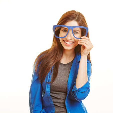 overachiever: Smiling happy woman looking through fake nerd glasses Stock Photo