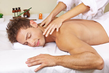 day spa: Relaxed man getting thai massage for his back in a day spa