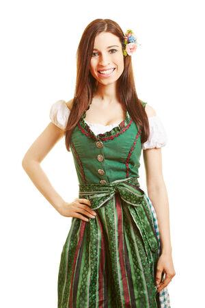 dirndl dress: Smiling happy bavarian woman in green dirndl dress Stock Photo