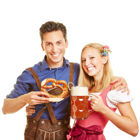 wiesn: Happy couple celebrating Oktoberfest with beer and pretzel