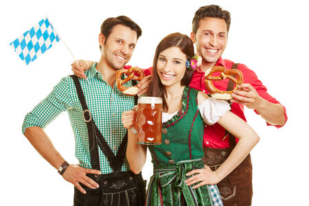 Smiling friends in Bavaria with beer and pretzel holding bavarian flag photo