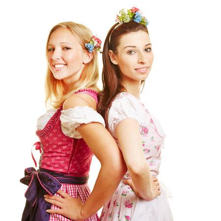dirndl dress: Two happy women in dirndl dress smiling at Oktoberfest Stock Photo