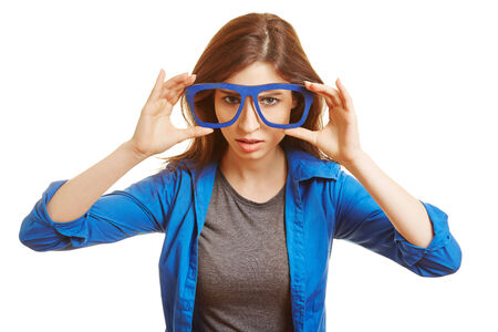 overachiever: Young woman holding fake nerd glasses in front of her face