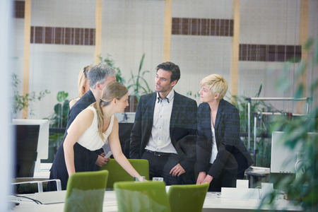 Negotiation of group of business people in an office Stock Photo