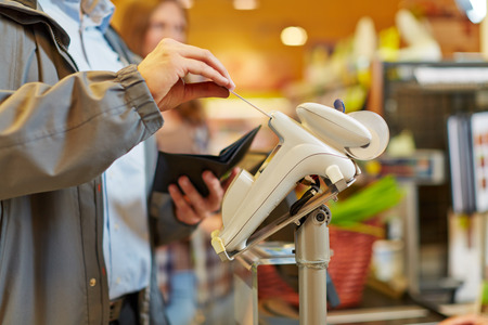 supermarket checkout: Man paying with credit card at supermarket checkout Stock Photo