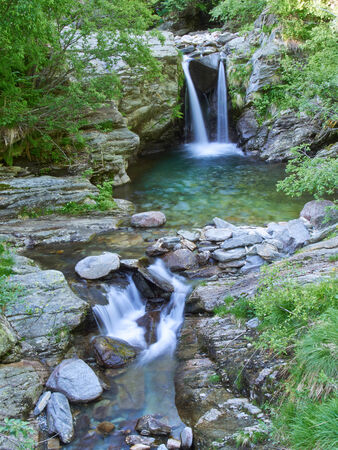 day trip: Idyllic waterfall in forest of the Italian Alps in the Vale Grande