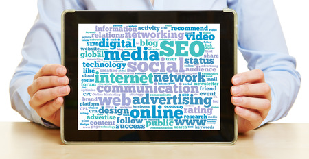 Hands holding a tablet computer with social media communication concept photo