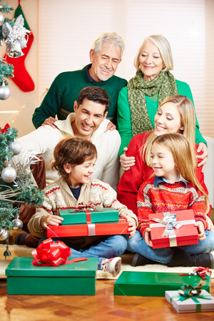 Happy family with three generations celebrating christmas with gifts photo