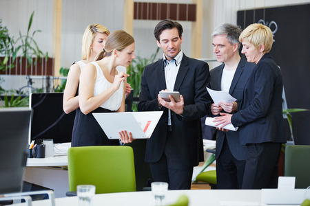 Group of business people working with tablet PC in office