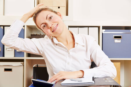 muscle tension: Business woman stretching her tense nape in the office Stock Photo