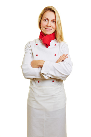 workwear: Young smiling woman as cook in apprenticeship with workwear