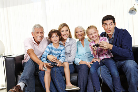 Family playing video game together on Smart TV in living room