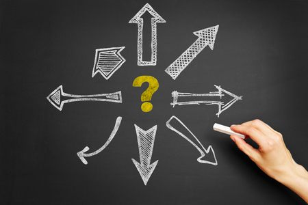 choose university: Hand drawing questionmark and arrows on blackboard Stock Photo