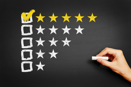 Hand draws concept for feedback with five stars on blackboard