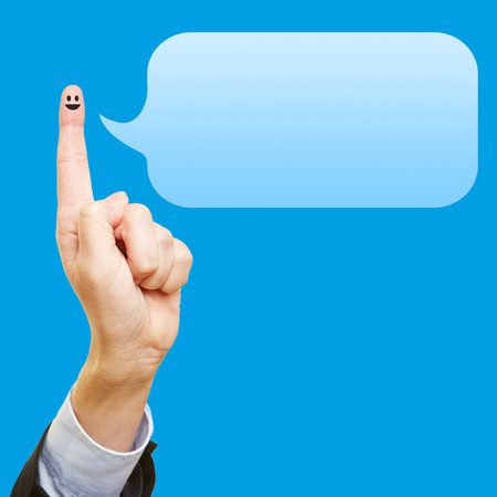 admonish: Funny index finger with smiley and an empty blue speech bubble