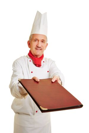 workwear: Chef cook in workwear offering menu card to a guest