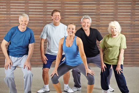 Happy senior group taking dancing lessons together in a gym
