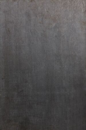 blank slate: Empty blackboard with slight rests of chalk as background