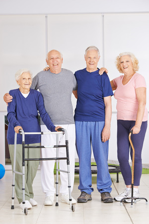 old age home: Old men and senior women standing together in a nursing home