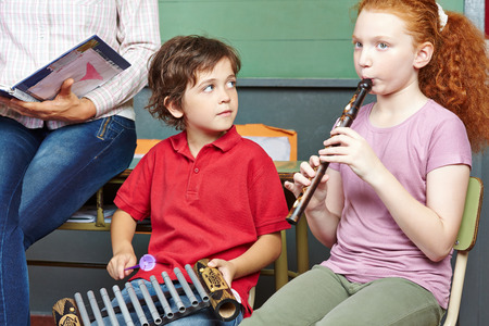 Children having music lessons in elementary school class Stock Photo